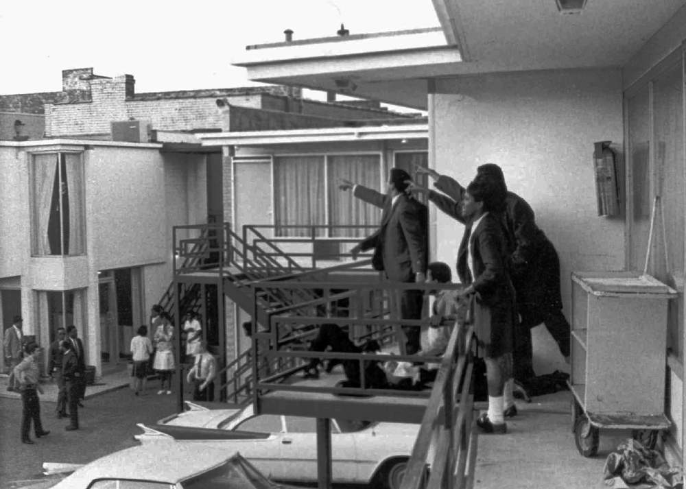 This 1968 photo was taken minutes after an assassin's bullet struck Dr. Martin Luther King Jr. at the Lorraine Motel in Memphis, Tenn., on April 4, 1968. According to the photographer, Joseph Louw, the men at right, several of Dr. King's aides, stand over King's body as they point out to police where they heard the shot. In the center of the photo is Andrew Young. AP Photo\/Files, Copyright 1968 Time Inc.