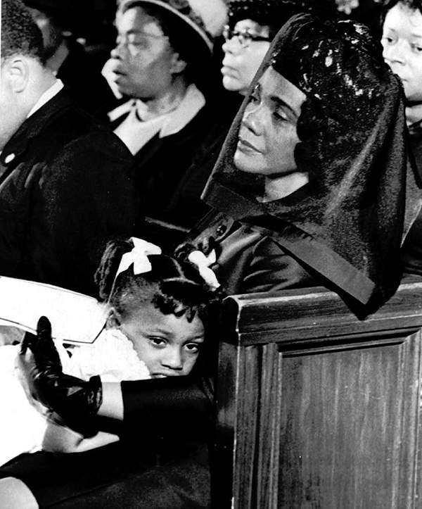Coretta Scott King and her daughter Bernice, 5, are shown April 9, 1968, attending the funeral of her husband in this Pulitzer-prize winning photograph taken by Moneta J. Sleet, Jr. Sleet was the first African-American to win a Pulitzer Prize for photography. AP Photo\/Moneta J. Sleet, Jr.